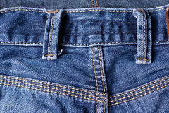 Jeans close-up, seams, belt loops. Interlacing the fabric with a Royalty Free Stock Photos