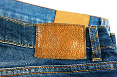 Jeans closeup brown leather label Stock Image