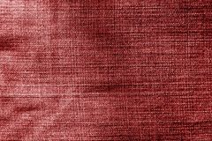Jeans cloth pattern in red color. Abstract background and texture for design Royalty Free Stock Photos