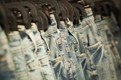 Jeans in a clothes rail. Inside a store Royalty Free Stock Photo