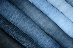 Jeans combined in a pile Royalty Free Stock Images