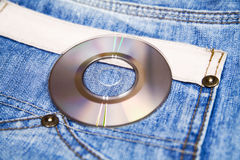 Jeans and compact disk Royalty Free Stock Photo