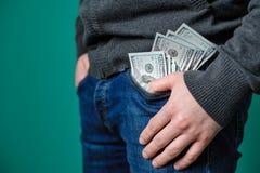 Jeans con i dollari nella casella Fotografie Stock