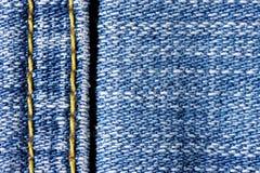 Jeans con il punto giallo Fotografia Stock