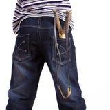 Jeans con uno slingshot in sua casella Fotografia Stock Libera da Diritti