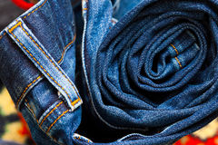 Jeans constricted into a roll Stock Photo