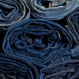 Jeans constricted in rolls Stock Photo
