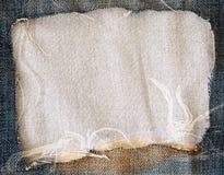Jeans déchirés bleus et texture de tissu Photo stock