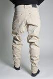 Jeans de la jeunesse mis sur le type Photographie stock