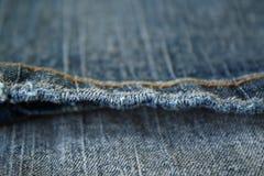 Jeans. De naad. De achtergrond. Stock Afbeeldingen