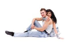 Jeans de port de jeunes couples de forme physique dans le studio Photo libre de droits