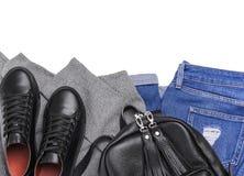 Jeans de sac à dos d'espadrilles et un chandail léger Photographie stock libre de droits