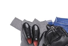 Jeans de sac à dos d'espadrilles et un chandail léger Photos libres de droits