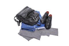 Jeans de sac à dos d'espadrilles et un chandail léger Photos stock