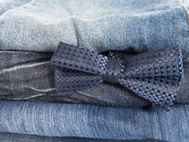Jeans and decorative tie Stock Image
