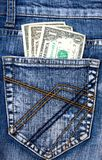 Jeans del denim con soldi in casella posteriore Immagini Stock Libere da Diritti
