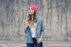 Jeans denim casual stree shirt, stylish style trendy model lady teen age teenager hipster, pink bright, white t-shirt student mode royalty free stock photo