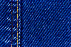 Jeans denim and seam. Macro of jeans denim and seam, abstract textile background royalty free stock images