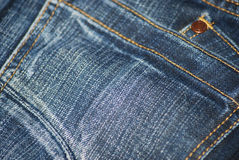 Jeans Detail. Close up of pocket of washed blue jeans stock images