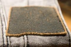 Jeans di cuoio del contrassegno Fotografia Stock Libera da Diritti