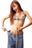 Jeans di prova della ragazza Fotografia Stock
