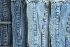 Jeans of different colors as background. Space for text royalty free stock images