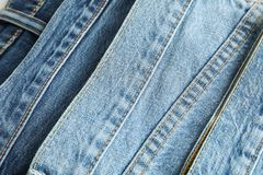 Jeans of different colors as background. Space for text royalty free stock photos