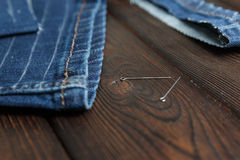 Jeans with dressmaking sewing utensils needlework Royalty Free Stock Images