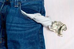 Jeans with empty pocket and the last one dollar. Stock Image