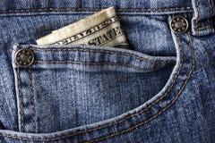 Jeans en een dollarrekening Stock Afbeelding