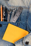 A jeans with engineer tools and note paper. Royalty Free Stock Photo