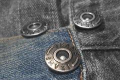 Jeans et boutons Photos libres de droits