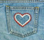 Jeans et poche de forme de coeur Photo libre de droits