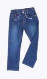 jeans för ungar eller blått färgar jeans på en bakgrund Arkivbilder