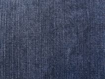 Jeans fabric. Close-up of dark blue jeans fabric, frontal view royalty free stock photography