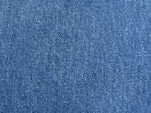 Jeans fabric. Close-up of blue jeans fabric, frontal view stock photography