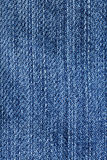 Jeans fabric closeup - blue denim weave texture Royalty Free Stock Photos