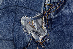 Jeans fabric with fissure Stock Images