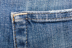Jeans fabric texture. Worn blue jeans fabric texture Stock Photography