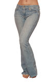 Jeans are on female slender figure royalty free stock photography
