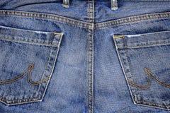 Jeans flåsar med fack Grov bomullstvilltygnärbild Jeansbakgrundstextur Arkivbilder