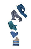 Jeans flies on a pile. Isolated on white background royalty free stock images