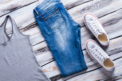 Jeans and gray tank top. Stock Images