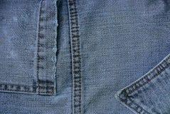 Jeans gris de texture de tissu avec une poche image libre de droits