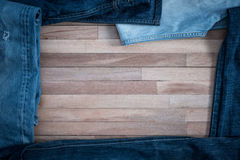 Jeans on a grunge wooden background Stock Image
