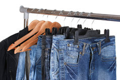 Jeans on hangers Royalty Free Stock Images
