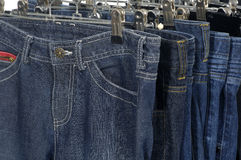 Jeans hanging stock image