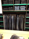 Jeans hanging. On a hanger in the closet. Selling jeans in a shop in Kiev, Ukraine. February 2015 stock photo