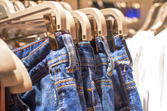 Jeans hanging on a hanger in the store Royalty Free Stock Image