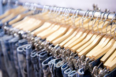 Jeans hanging on rack Royalty Free Stock Image